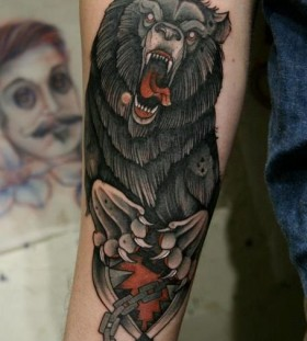 Angry black bear tattoo on arm