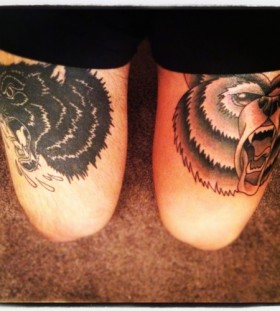 Angry black cat and brown bear tattoo on leg