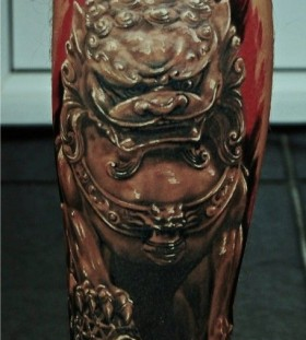 Angry egypt style dog tattoo on leg