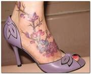 Ankle flowers tattoo with shoes