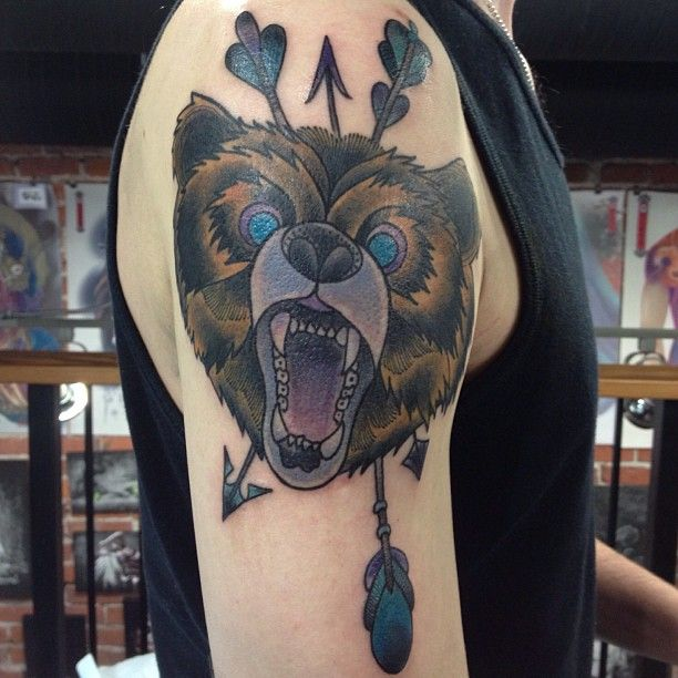 Arrow and angry bear tattoo on shoulder