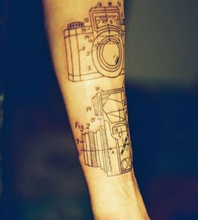 Awesome black camera tattoo on arm