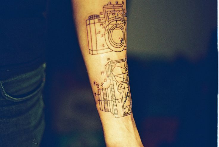 Awesome black camera tattoo on arm