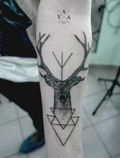 Awesome black deer tattoo