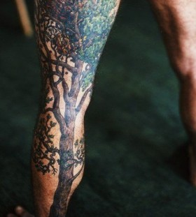 Awesome black tree tattoo on leg