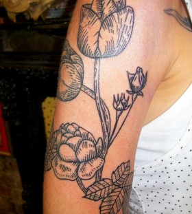 Awesome black tulips tattoo