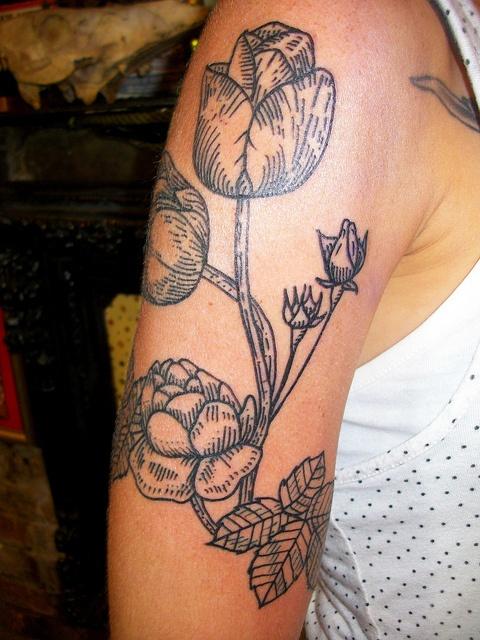 Awesome black tulips tattoo