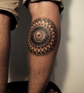 Awesome champ eye tattoo on leg