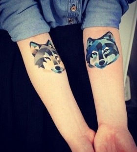 Awesome colors ornaments wolf tattoo on arm