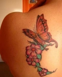 Awesome flower and butterfly tattoo on shoulder