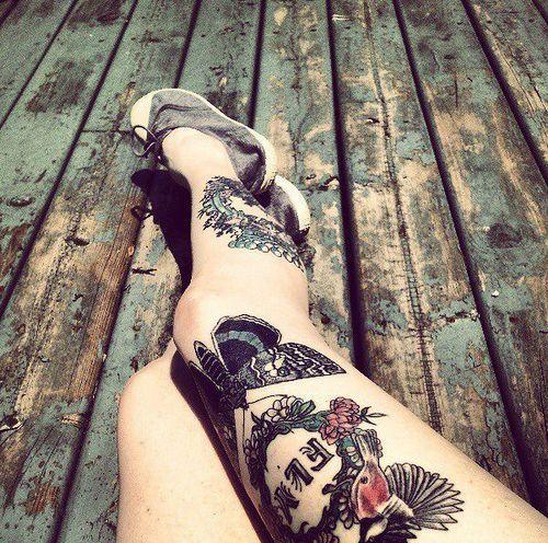 Awesome girl bird tattoo on leg