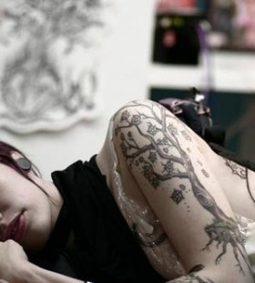 Awesome girl's tree tattoo on arm
