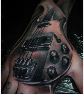 Awesome guitar ornaments tattoo