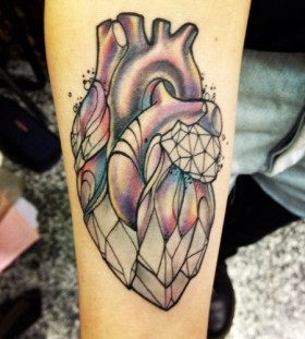 Awesome heart from crystal tattoo on leg