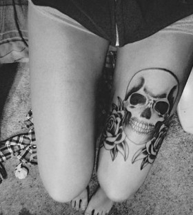 Awesome skull and rose tattoo on leg