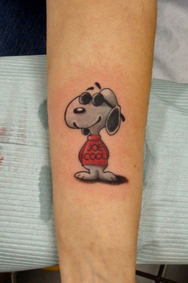 Awesome snoopy tattoo on arm
