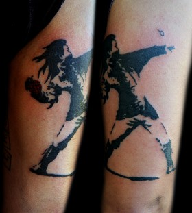 Bansky- girl with granade tattoo