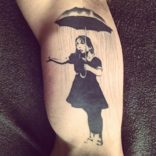 Bansky- girl with umbrella tattoo