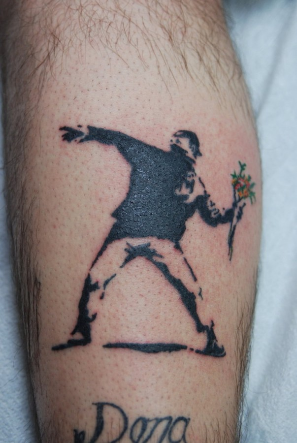 Bansky guy throwing flowers tattoo