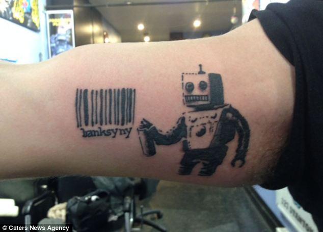 Bansky robot tattoo