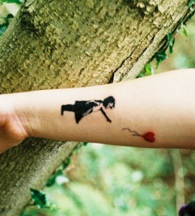 Bansky tattoo on hand