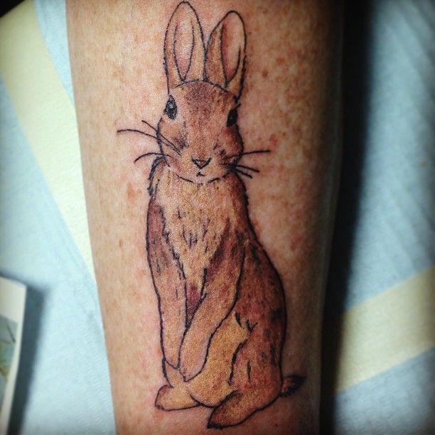 Beautiful brown rabbit tattoo on arm
