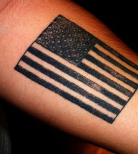 Big tattoo with flag on the hand