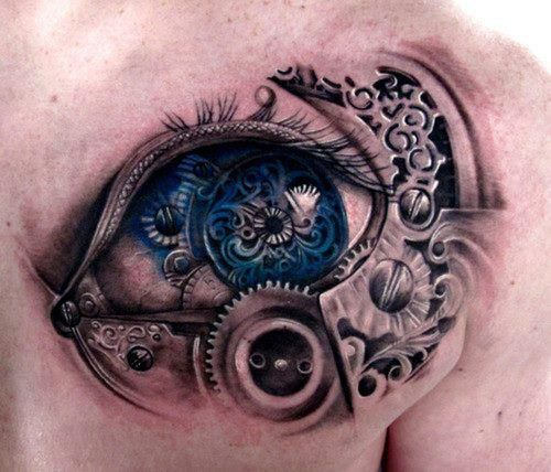 Biomechanical blue eye tattoo on shoulder