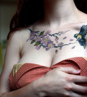 Bird and purple flower tattoo on chest