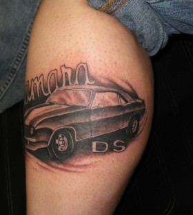 Black DS style car tattoo on leg