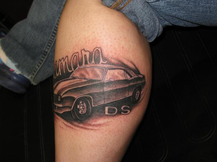 Black DS style car tattoo on leg