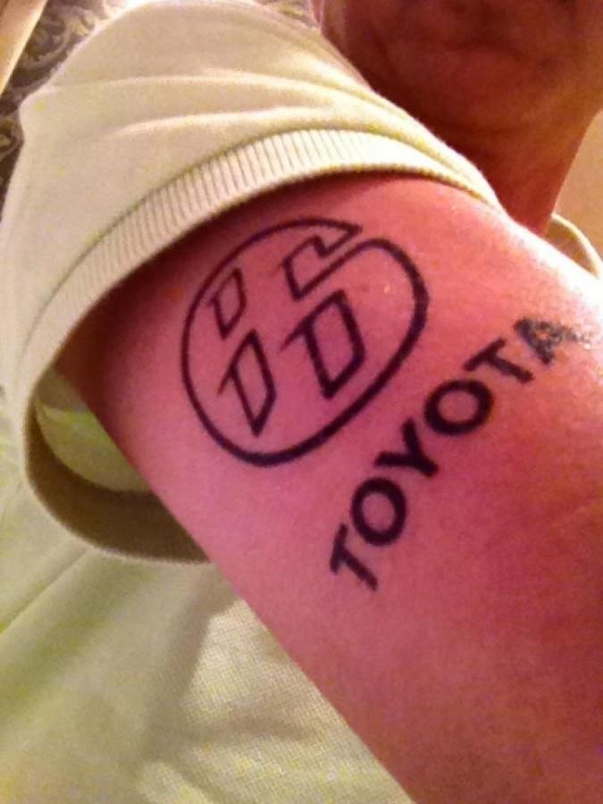Black Toyota car tattoo on arm