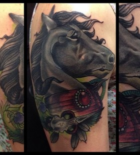 Black adorable horse tattoo on arm