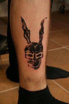 Black adorable rabbit tattoo on leg