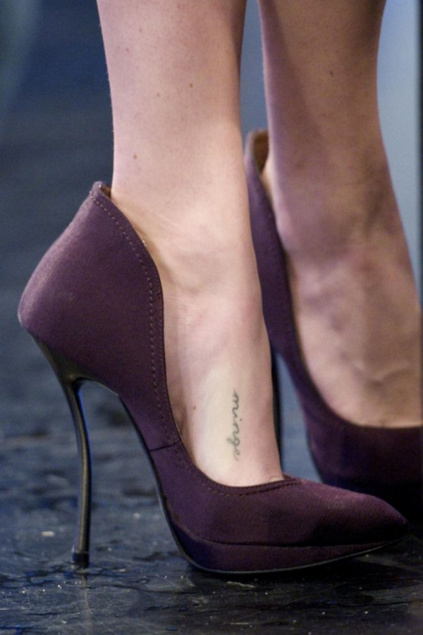 Black adorable tattoo with shoes