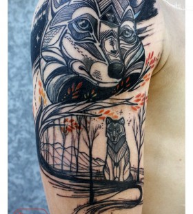 Black adorable wolf tattoo on arm