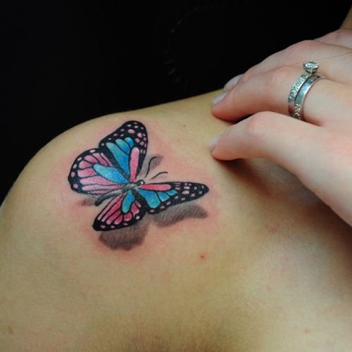 Black and red butterfly tattoo on shoulder