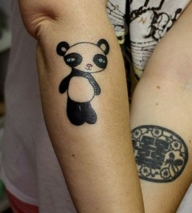 Black and white bear tattoo on arm