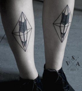 Black and white crystal tattoo on leg