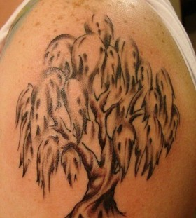 Black and white tree tattoo on shoulder
