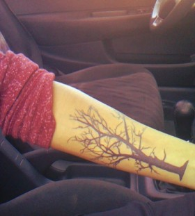 Black awesome tree tattoo on arm