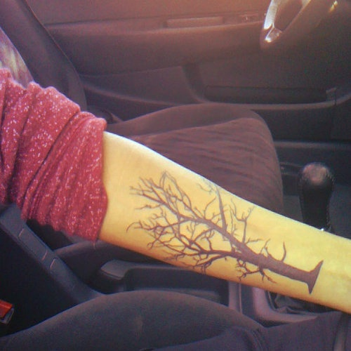 Black awesome tree tattoo on arm