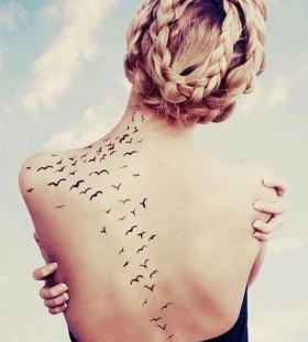 Black back birds tattoo