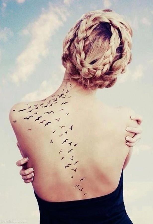 Black back birds tattoo