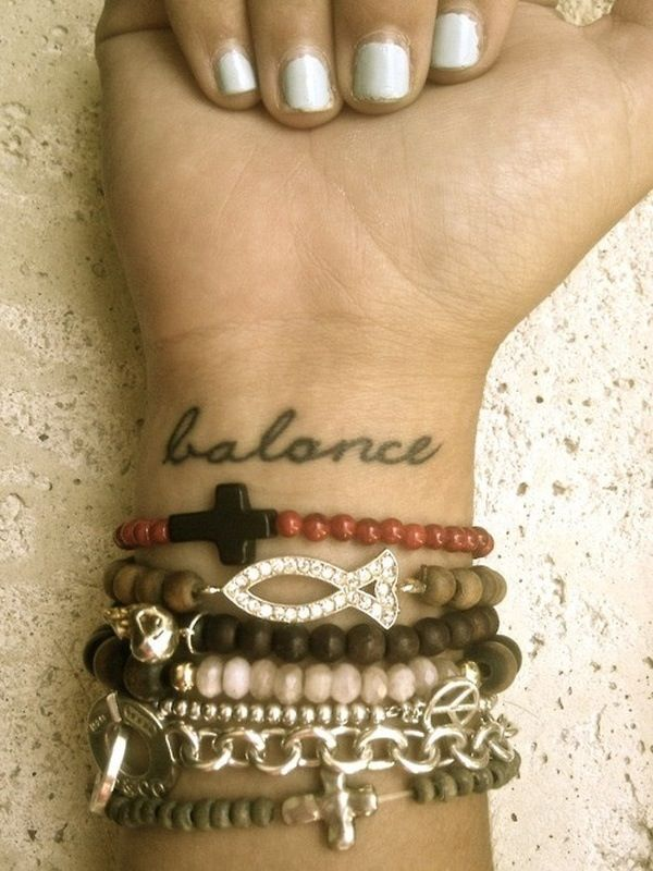 Black balance quote tattoo on arm