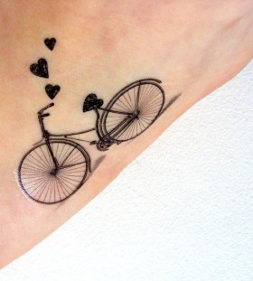 Black bicycle tattoo