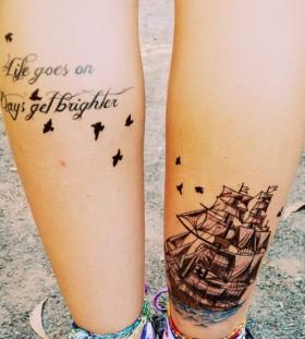Black birds and ship tattoo on leg