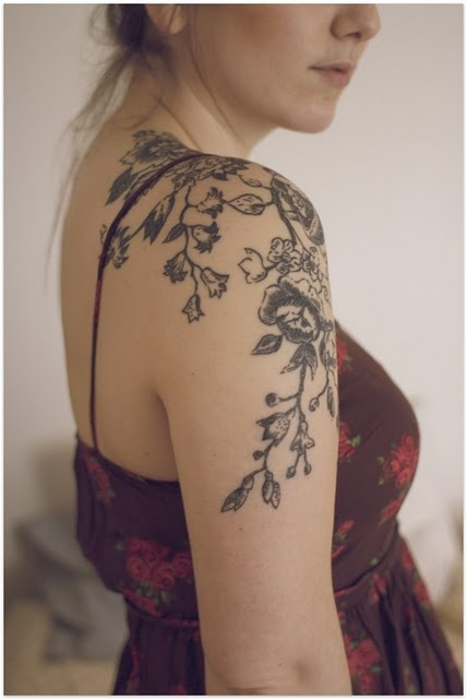 Black blossom cherry tattoo on arm