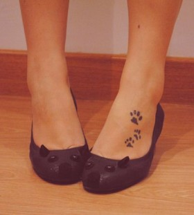 Black cat tattoo with shoes