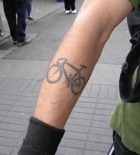 Black cute bicycle tattoo on arm
